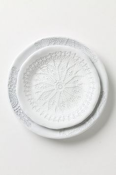 I want this dinner set very badly! With just two of us it is very affordable! Penumbral Doily Dinnerware anthropologie.com $12-18
