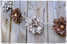 "DIY Pinecone ""Flower"" Garland: perfect for rustic Christmas or rustic autumn decor."