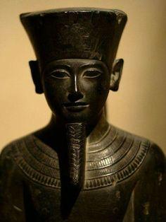 Egyptian standing graywacke statue of Amun from Amarna, 1332-1292 B.C.