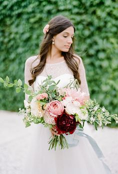 A Fall Bouquet of White, Red, and Pink Peonies, Garden Roses, Zinnias, and Greenery. A natural bouquet comprised of deep red dahlias, peonies, chrysanthemums, and greenery, created by Anchor and Grace.