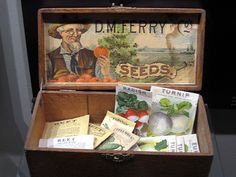 "D.M. Ferry & Co. retail display seed box. D.M. Ferry invented seed ""commission box"" retail displays and was one of the first to use brightly colored seed packets."