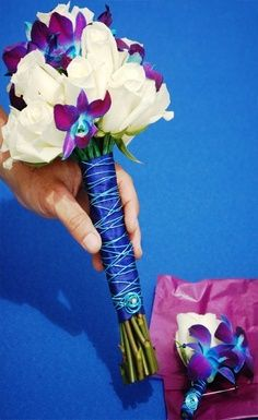 Blue dendrobium orchid bouquet and boutonnière for bridesmaids and groomsmen. Done. It's official.
