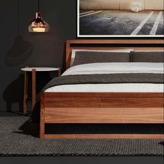 The Woodrow Bed with Free Range Side Table and Trace Pendant.
