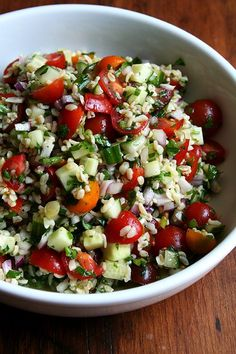 Tabbouleh // In this salad, the bulgur plays as much of a role as the cucumbers, tomatoes, red onion, scallions and herbs (parsley, chives and mint). Here, too, I've used extra-coarse bulgur (found at Greek, Middle Eastern and whole food markets), which is chewier than fine bulgur, tasting more like barley or farro than couscous or quinoa. // @alexandracooks