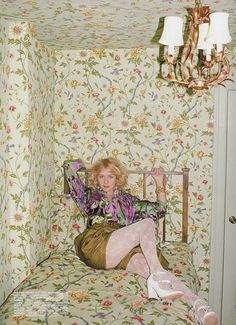 Chloe Sevigny camouflaged by matching wallpaper and bedding in her New York apartment, as shown in a 2007 House & Garden feature