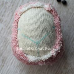stitch to the beige sock ball. Make sure the raw edge is caught in the thread so that it won't stray out from the head. 3.