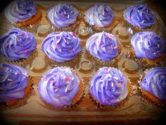 purple and white swirled oreo cupcakes with cream cheese icing