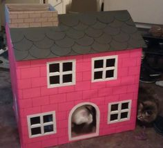 A red brick house that the dog can't huff, and puff, and blow down. | Community Post: 19 Spectacular Cat Houses Made Entirely Out Of Cardboard