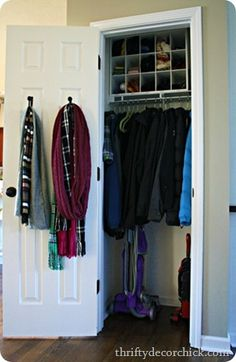 coat closet organization - love the top shelf. Now you can see what's actually up there.