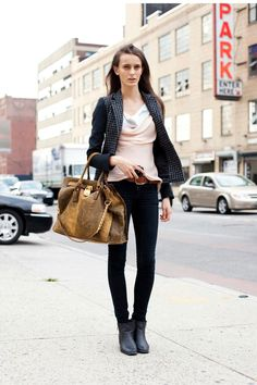 Erjona Ala with her Michael Kors Hamilton handbag. New York, October 2011