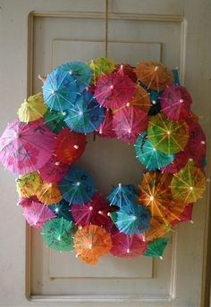 Umbrellas tropical wreath Looking for an easy colorful way to decorate warm weather patio celebrations? All you need is a wreath form and a bag of drink parasols (found at party supply stores). Hot glue your mini umbrellas into wreath