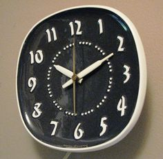 Mid Century General Electric Ceramic Clock  C. 1953 -  Design by Russel Wright. $58.00, via Etsy.