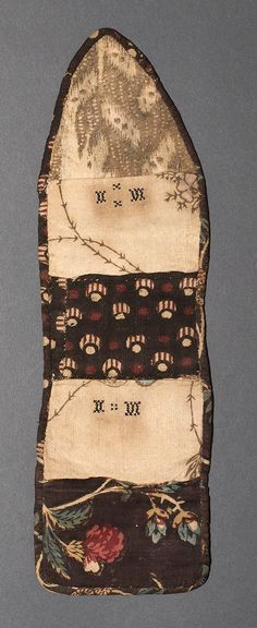 1969.3106 Needlework Case    Museum Object Number: 1969.3106   Complete Details   Object Number  1969.3106  Object Name  Sewing roll (Huswif)  Category  Textiles (Needlework)  Credit Line/Donor  Bequest of Henry Francis du Pont  Place of Origin  United States, North America  Date  1780-1810  Materials  Cotton; Linen  Dimensions (inches)  10.25 (H) , 3.06 (W)  Dimensions (centimeters)  26.04 (H) , 7.78 (W)  Object Description  Text available soon.