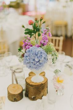 Log slices and milk glass vases from a wedding I did this summer.