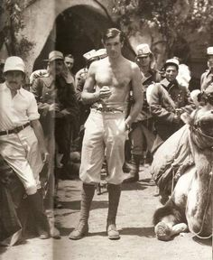 MOROCCO (1930) - Gary Cooper smokes a cigarette while on break during filming - Paramount Pictures.