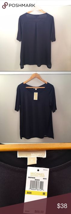 {Michael Kors} black top T-shirt- like material in front with long, sheer back. Gold bar detail. Longer short sleeves for a polished look. Michael Kors Tops Tunics
