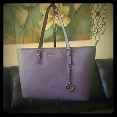 Michael Kors Jets Set Travel Wisteria Brand NEW Michael Kors purple tote handbag. Pristine condition comes with its protective cover. Interior features 1 zip pocket, 3 open pocket 1 cell phone pocket and key holder. Michael Kors Bags Totes