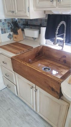 We specialize in these wooden style sinks, have been tested and mother approved. they are layered with a tough water proof epoxy resin, and mounting braces for hold and support. Please contact us with any other questions and request for size color and any Home Diy, Home Kitchens, Rustic Kitchen, Kitchen Remodel, Kitchen Design, Rustic House, Home Remodeling, Home Decor Kitchen, Home Decor