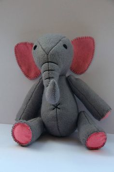 A hand-sewn elephant made of felt with great attention to detail. Either with trunk down or up. Please specify which shape is required when ordering! For Dekoration or for the children to play, its always an eye-catcher. You get 1 Elephant Size / Weight / Dimensions: Big: Height: 17 cm