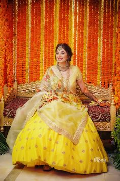 Looking for A bride to be in a yellow lehenga for her mehndi ceremony? Browse of latest bridal photos, lehenga & jewelry designs, decor ideas, etc. Indian Bridal Photos, Indian Wedding Gowns, Indian Bridal Outfits, Gujarati Wedding, Wedding Photos, Wedding Ideas, Bridal Mehndi Dresses, Mehendi Outfits, Wedding Dresses For Girls
