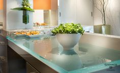 With a remarkable blend of function and art, ThinkGlass offers glass kitchen countertops, backsplashes and raised bars that literally transform your eating area. Our exclusive technology can make your kitchen glass countertops truly unique. Just imagine…