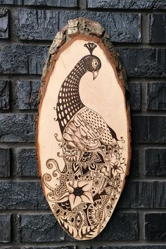 This beautiful Peacock has been hand drawn and then wood burned onto a natural Bass wood tree slice. The process: I free handed a rough