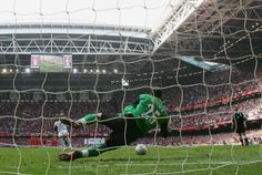 Jose Reina the Liverpool goalkeeper saves penalty from Anton Ferdinand of West Ham United which gives victory to Liverpool in the FA Cup Final match...