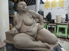 This is a life-size pre-cast clay sculpture of a naked fat woman. The model is Julie Srika. The sculptor is Ramon Sierra. I think it's...