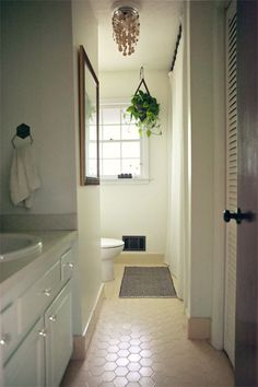white bathroom + vintage yellow hex tile