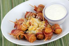 BACON WRAPPED TATER TOTS RECIPE Ingredients: 1 (32 ounce) bag frozen tater tots 12 ounces bacon (each slice cut in ½) 16 ounces pickled jalapeno peppers (sliced) 1 cup Colby-jack cheese ½ cup ranch dressing toothpicks  Cooking Instructions: bacon_wrapped_tater_tots_3bacon_wrapped_tater_tots_4 Step 1: Slightly defrost the tater tots to allow the toothpicks to go through. Hold a jalapeno slice around a tater tot and then wrap ½ slice of bacon around and secure it together with a toothpick…
