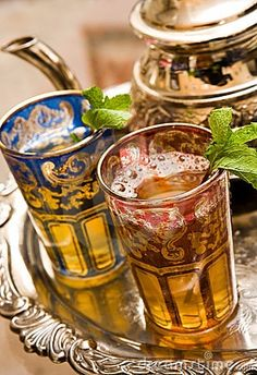 Moroccan Mint Tea served in beautiful crystal glasses. Those shown here are cobalt and ruby, gilded, by Cristal Saint Louis, France. They also come in Emerald,  and can be used for wine glasses at the Jewish Passover dinner called the Seder.