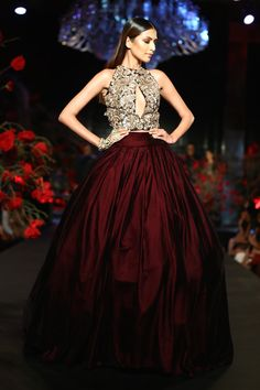 What a beauty! By Manish Malhotra on thedelhibride.com  Outfit details: Burgundy Ball Gown Skirt with Crop Top 3D Silver Floral Motifs - Manish Malhotra - Amazon India Couture Week 2015