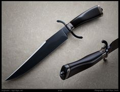This knife by Kyle Royer has the perfect balance of form and function. It's a deadly piece of beauty.