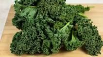 Steamed Kale, place on plate top off wtih over easy eggs ( 2) steam purple onions with kale to get more flavor, sprinkle garlic powder. Mix well inside steamer place eggs on top, chop and enjoy!