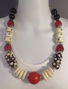 Bold African statement necklace: Red wood and resin beads, white bone discs, polka dot bone beads, black wood beads - Michela Rae