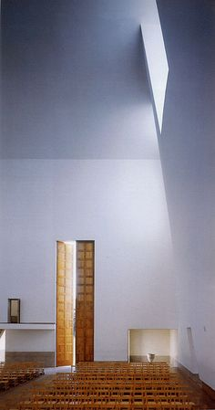 extremely tall doors:  Parish Church Complex of Marco de Canevezes, Portugal - by Alvaro Siza