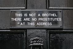 """A sign reading """"This is not a brothel there are no prostitutes at this address"""" is pictured above a door knocker in the Soho district of London Self Promotion, Door Signs, Give It To Me, How To Make, Funny Signs, Soho, Nevada, Just In Case, Signage"""