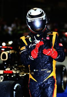Kimi Raikkonen of Finland and Lotus celebrates in parc ferme after winning the Abu Dhabi Formula One Grand Prix