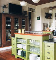 great kitchen island, i love how its open and shows all the dishes, and the wood and hutch are obviously my style