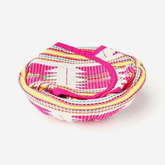 """Inspired by traditional mayan textiles these beautiful products keep tortillas, bread, naan, or pita bread warm and delicious. Removable fabric cover with a natural cane basket.  Material: Acrylic Yarn, Cotton Size: 9"""""""
