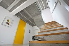 Tim Pauly Image 3 – Stairwell with polished concrete floor, white walls and concrete stairs with timber treads. We would prefer the ceiling to be white also. Ideally the door is an entrance to a garage for an upstairs apartment.