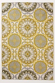 Brilliant blossoms in mustard yellow, palest blue: like spring on your living room floor. $898   I love this rug! Would cover the awful blue carpet too.