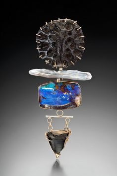 Lisa Ben-Zeev:  Pendant /pin. fossilized turtle scat, biwa pearl, boulder opal, fossilized alligator tooth