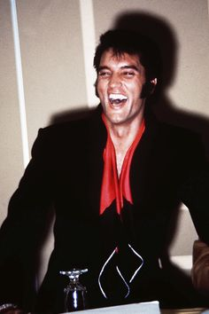 Elvis Presley,THIS HAS TO BE THE HAPPIEST PICTURE I HAVE SEEN OF ELVIS...SOMEONE MUST HAVE TOLD HIM A GOOD JOKE...