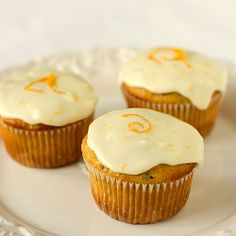 zucchini pineapple cupcakes with orange sour cream frosting. shut up.