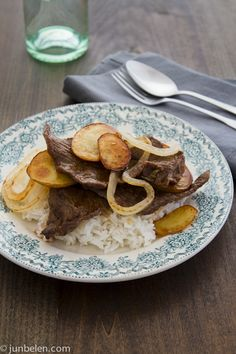 Bistek http://blog.junbelen.com/2012/08/08/how-to-make-bistek-filipino-style-pan-fried-beef-steak/#