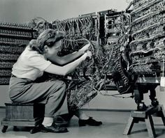 Photographer Berenice Abbott, 'Woman wiring an early IBM computer' from the Documenting Science series (1938-58)