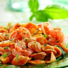 This quick-cooking, healthy dinner is a simple combination of zucchini, shrimp and pasta flecked with plenty of fresh basil. If you have leftover cooked pasta from another meal, use it and skip Step 2. Since the recipe combines a starch, vegetables and the shrimp, all you need is a fruit or vegetable salad to round out the menu. Recipe by Nancy Baggett for EatingWell.