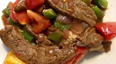 Beef top sirloin steak is sliced across the grain for tenderness, coated in a sweet-and-savory soy sauce marinade, then quickly stir fried with fresh green pepper, onion, and tomatoes.