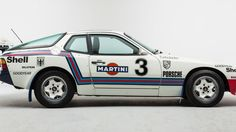 I was searching for rally Porsches (because I am deeply in love with rally Porsches) when I came across this vintage 1981 Porsche Rally 924 in a lovely Martini livery. It's perfect.